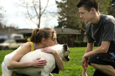 Perro y sus dueños